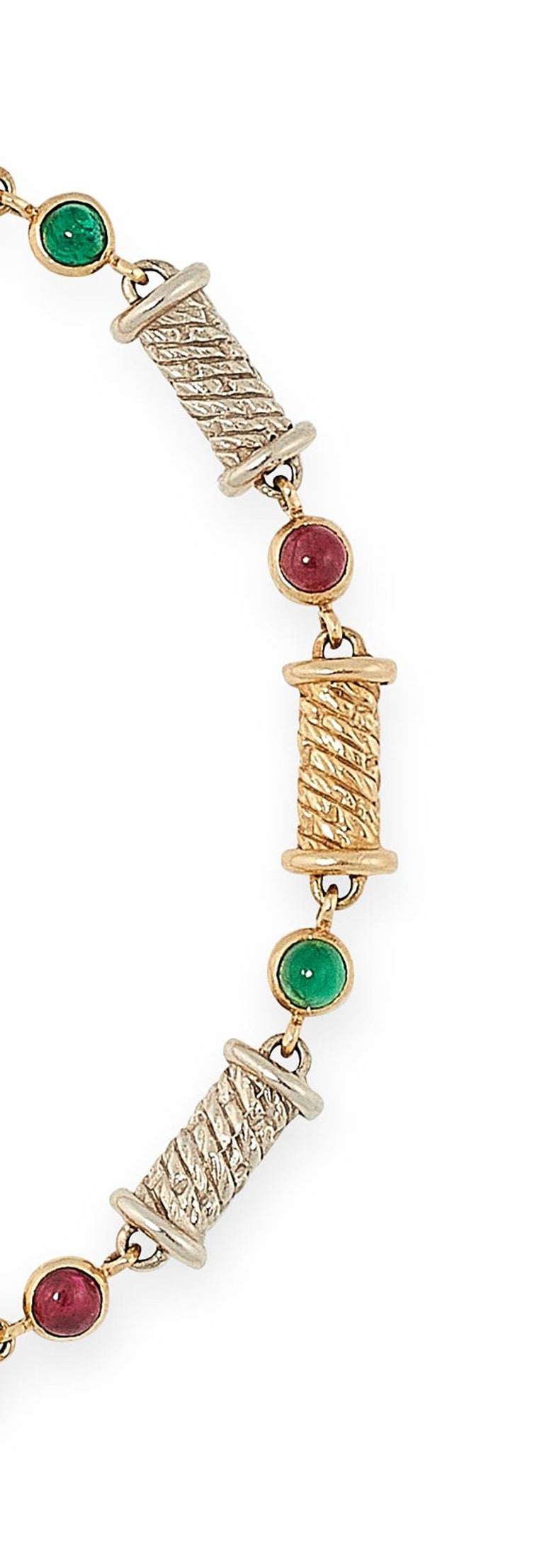 A fun and lively Van Cleef & Arpels ruby and emerald bracelet formed of fancy rope decorated links in alternating yellow and white gold, punctuated by round cabochon rubies and emeralds. Signed VCA and numbered, French assay marks for 18K