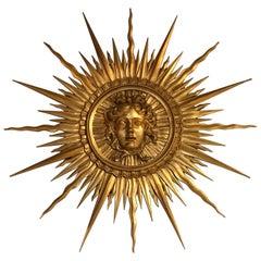 Very Fine Giltwood Sunburst Ornament Depicting the Head of Apollo
