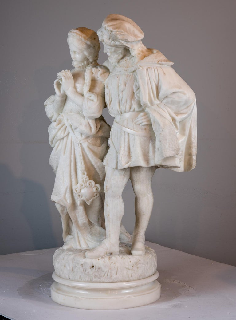 A fine quality Carrara marble sculpture of lovers. The young maiden holding a daisy while the gentleman embraces her pationately.  Artist: Attributed to Pasquale Romanelli (1812-1887) Origin: Italian Date: 19th century Size: 28 in. x 17 in.