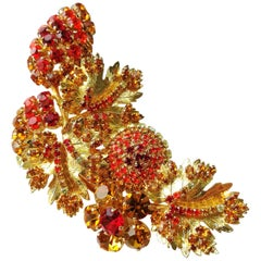 A very large coloured paste and gilt metal 'spray' brooch, Christian Dior, 1980s