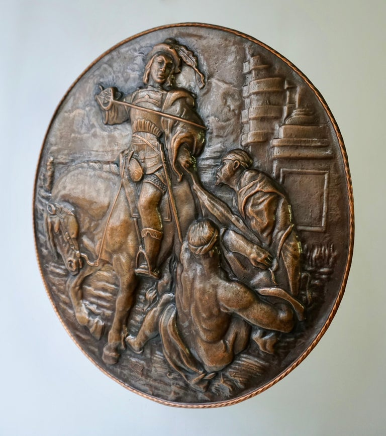 A very large copper wall plate depiction Saint Martin on horse in relief.