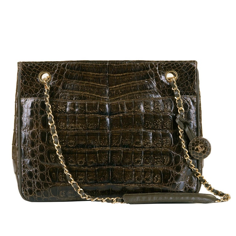 This exquisite vintage Chanel 28cm alligator shoulder bag, designed by Karl Lagerfeld, is from Chanel's 'Pret a Porter' Collection of 1985. With gold hardware, and a featured double 'C' logo tag, the bag is accented with matching brown lambskin