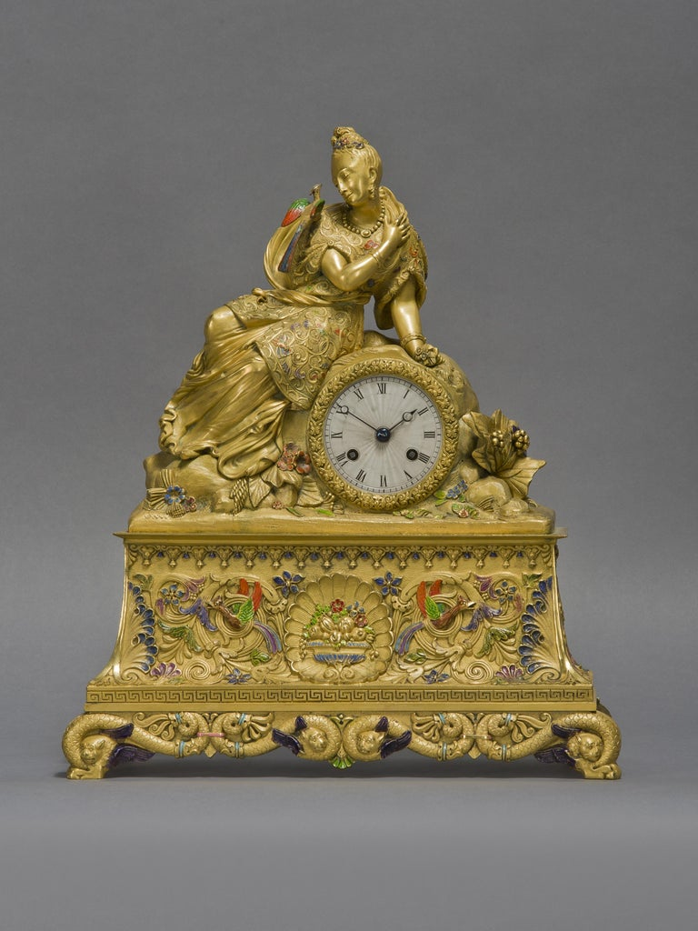 A very rare and important Chinoiserie style gilt-bronze and enamel figural clock.