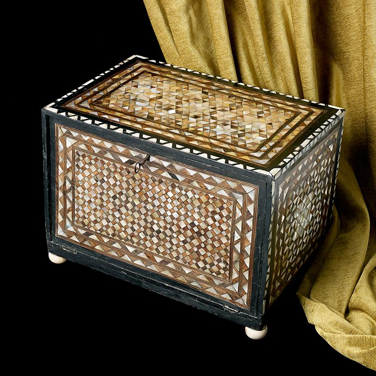 A very rare ottoman table box, the fall front opens to reveal an arrangement of 7 drawers; decorated throughout with differing patterns of tortoiseshell and mother of pearl; measures: approximate 17 1/2 inches wide, 12 1/2 inches high and 11 1/2