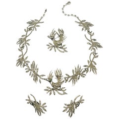 "A very rare paste ""bird with diamond"" 3 piece parure, Christian Dior, 1950s ."