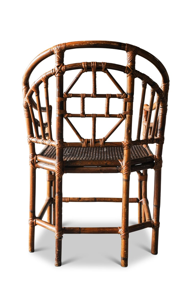 An early 20th century Victorian Chinese Chippendale faux bamboo conservatory armchair.