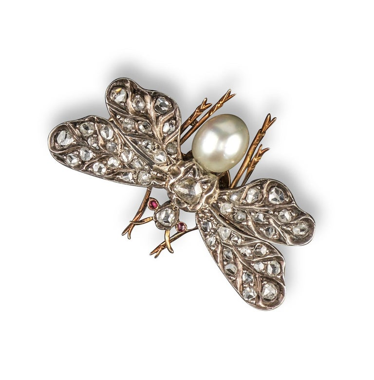 The wings pave-set with rose cut diamonds, the body formed from a pearl in silver and gold, 3.8cm wide