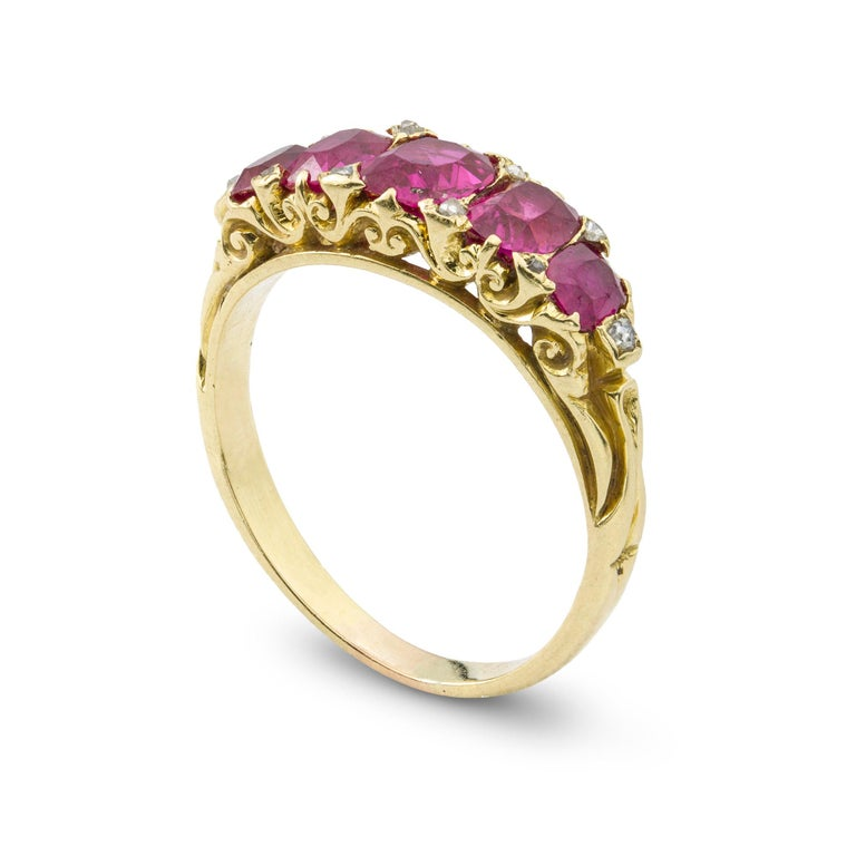 A Victorian five stone ruby ring, the five oval faceted rubies estimated to weigh one and a half carats in total accompanied by GCS report: 5776-6569 stating that the rubies to be of Burmese origin with no indication of heat-treatment, graduating