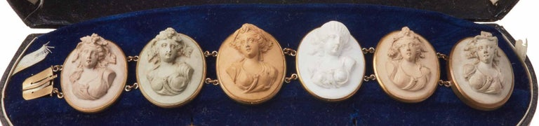 Comprising a carved large bracelet; a matching oval cameo brooch; a pair of matching drop earrings , in fitted case.
