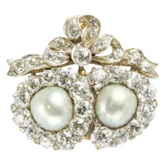 A Victorian Pearl and Diamond Double Heart Brooch