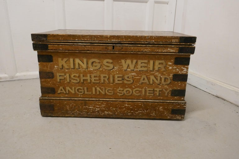 A Victorian Pine Newham and Son's fishermans chest   This is a best quality box, it has an original scumble finish and the interior is lined with the original decorative paper, the interior label states that it is Waterproof, possibly why it has