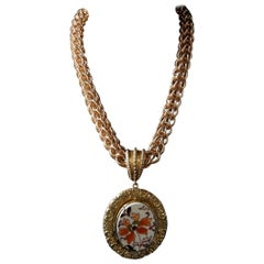 A Victorian porcelain pendant in a Bronze Chain by Patrizia Daliana