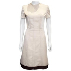 A vintage 1950s - 1960s cream fitted raw silk dress small