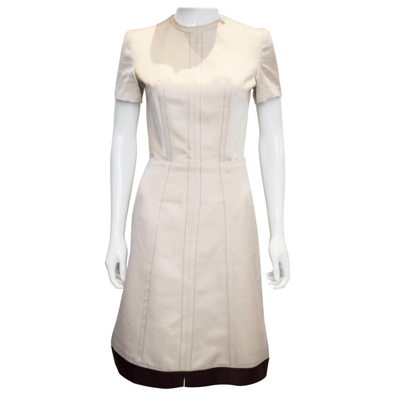 A vintage 1950s - 1960s cream fitted raw silk dress small For Sale