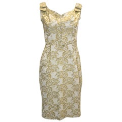 A vintage 1950s - 1960s olive green & gold brocade cinch wiggle cocktail dress