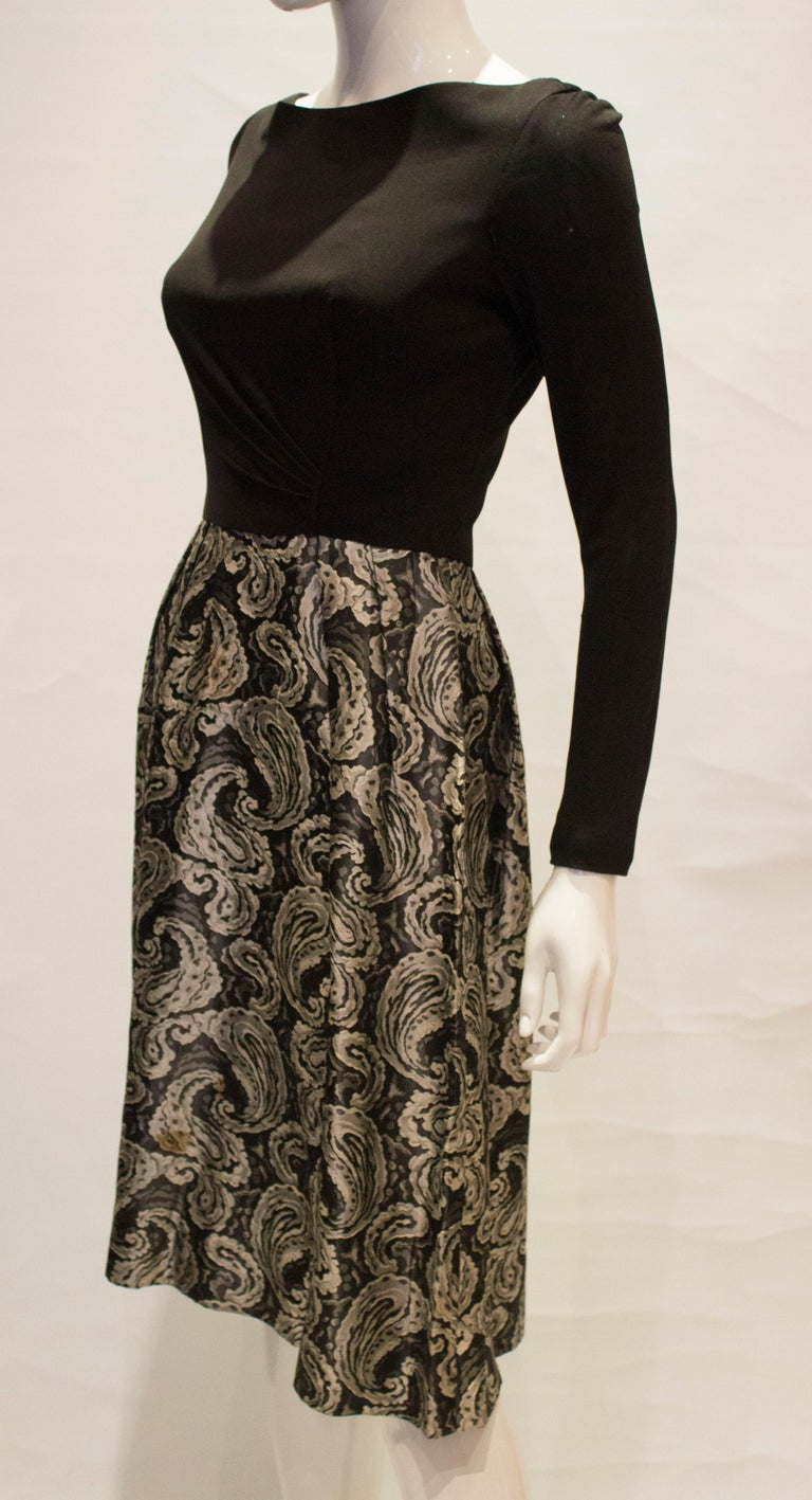 A vintage 1950s silver and black brocade party low back paisley dress small In Good Condition In London, GB