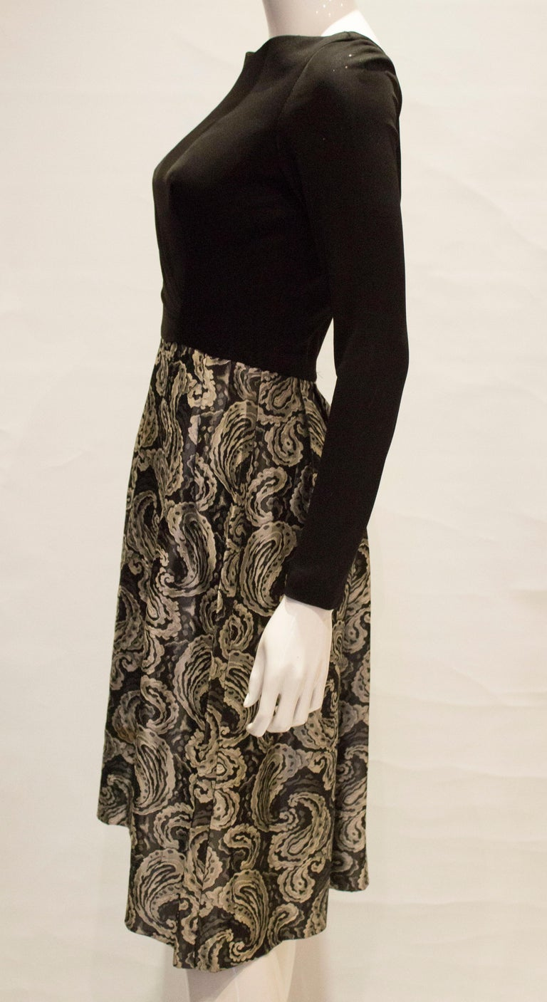 A vintage 1950s silver and black brocade party low back paisley dress small 1