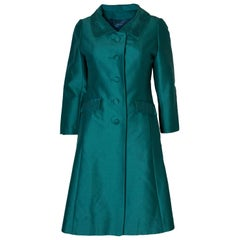 A Vintage 1960s Teal Coloured Evening Coat
