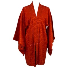 A vintage 1970s burnt orange  silk kimono