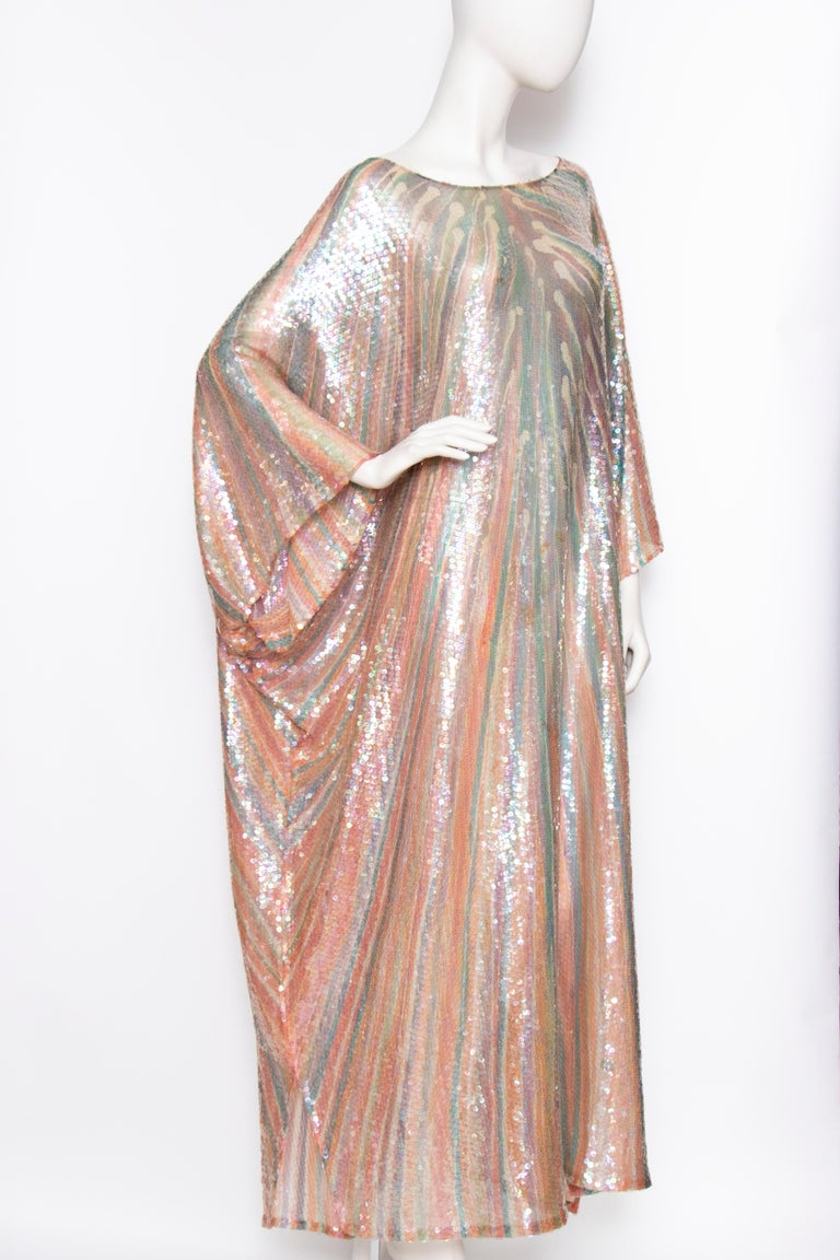 An incredible 1970s sheer Halston silk caftan dress with a round neckline covered in clear sequins.