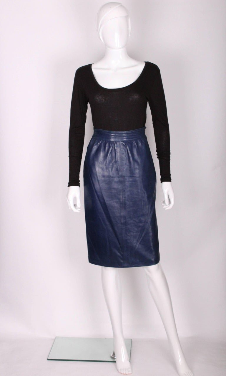 A stunning and very soft leather skirt by Yves Saint Laurent, Rive Gauche line. In a brilliant blue colour , this skirt has a side zip and button opening ,and a 7'' central back slit .