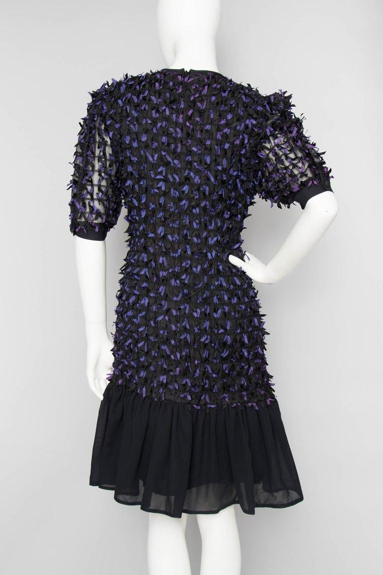 7f11c8e87ce72 A Vintage Givenchy Black Cocktail Dress With Purple Bows