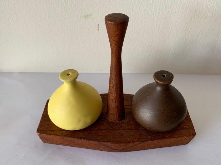 A charming salt and pepper set by Arni Form, Italy, circa 1960. Teak wood and ceramic, handmade.