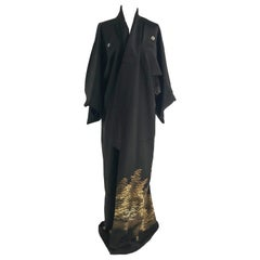 A vintage kimono embroidered and painted with golden maple trees.