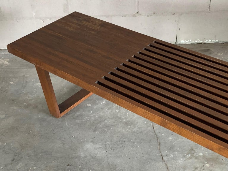 A Classic midcentury slat bench in the style of George Nelson, circa 1950s. Heavy and well made could used as a coffee table or display table.