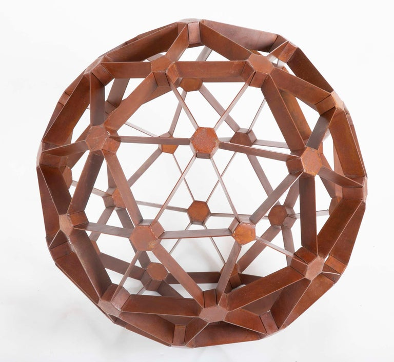 A geodesic sphere made of waxed steel in the manner of Buckmiester Fuller. A geodesic sphere or dome is a lightweight but very strong round structure made from interconnecting triangles. If the round structure is complete it's a geodesic sphere.