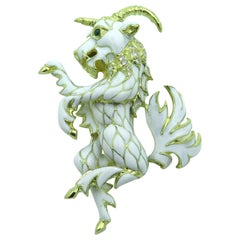 White Enamel, Emerald and Gold Ram Brooch