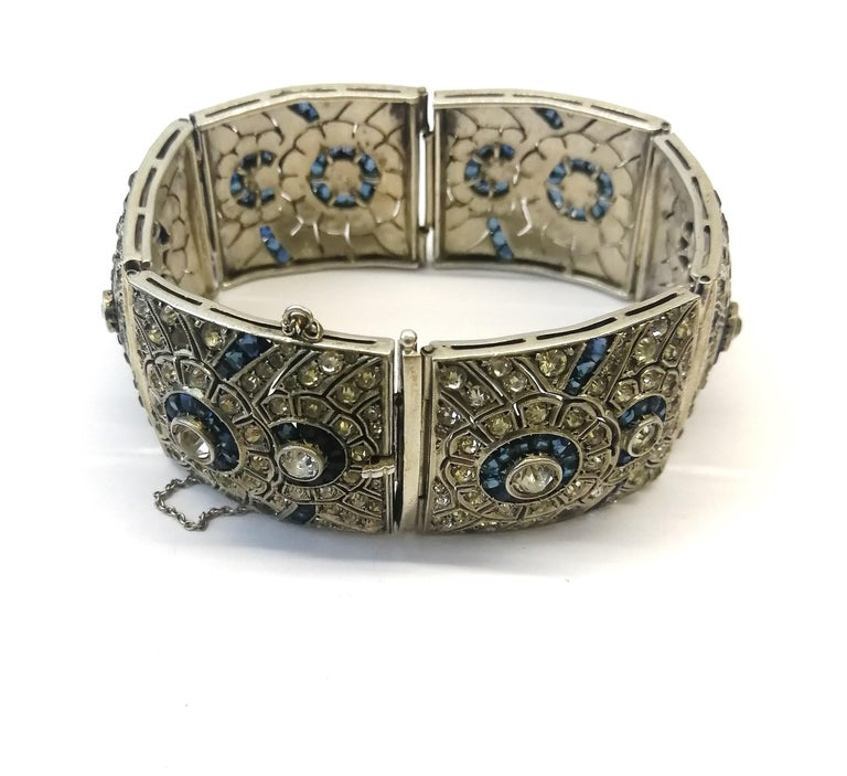 A wide silver, clear and sapphire paste Art Deco bracelet, France, 1920s 6