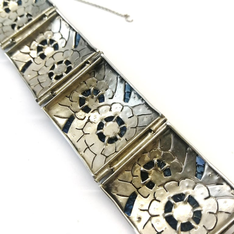 Women's A wide silver, clear and sapphire paste Art Deco bracelet, France, 1920s