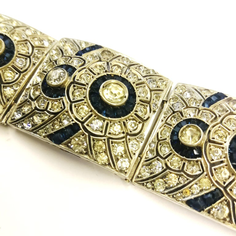A wide silver, clear and sapphire paste Art Deco bracelet, France, 1920s 1