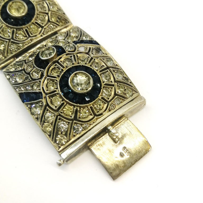 A wide silver, clear and sapphire paste Art Deco bracelet, France, 1920s 4