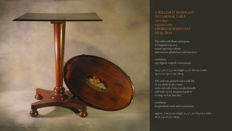 A William IV mahogany occasional table circa 1830 together with George III mahogany oval tray The table with flame mahogany rectangular top on a  round tapering column  and concave plinth base with bun feet.  condition: top slightly