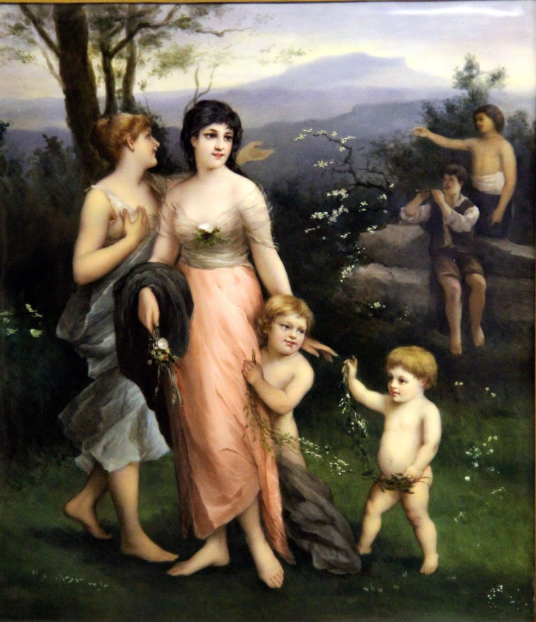 A wonderful late 19th-early 20th Berlin K.P.M. porcelain rectangular plaque  Painted landscape scene with two women and their children playing, the background with two men, one playing an instrument.  Impressed K.P.M and scepter marks, in the