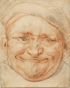 Head of a Cheerful Man Wearing a Cap
