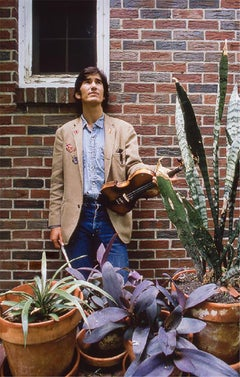 Townes in backyard, with violin, 1972