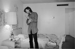 Kris Kristofferson, dressing in hotel room, circa 1970