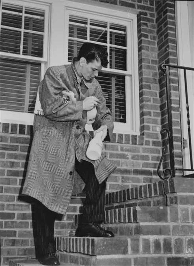 Frank Sinatra at his doorstep in Hoboken, NJ
