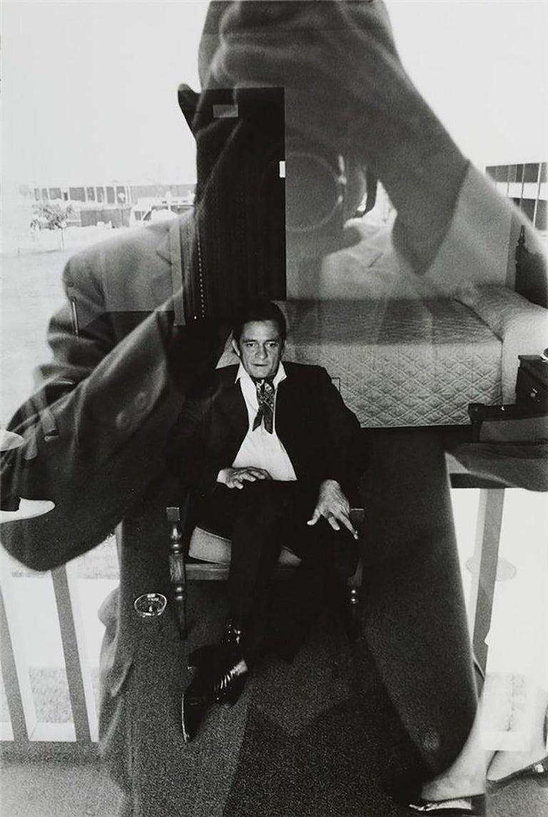 Duane Michals Black and White Photograph - Johnny Cash, motel room, 1969