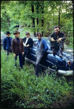 The Band, outside Big Pink, posing with his Hudson, Woodstock, NY, 1969