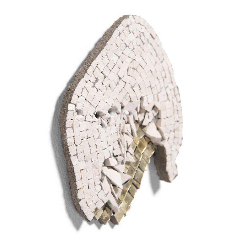 """In the series """"Clouded,"""" Toyoharu Kii honors the fullness of life and its continual rebirth. In some works, white tesserae assume abstract profiles. In others, irregular shapes contain a disorderly array of jagged tiles, suggesting the unexpected"""