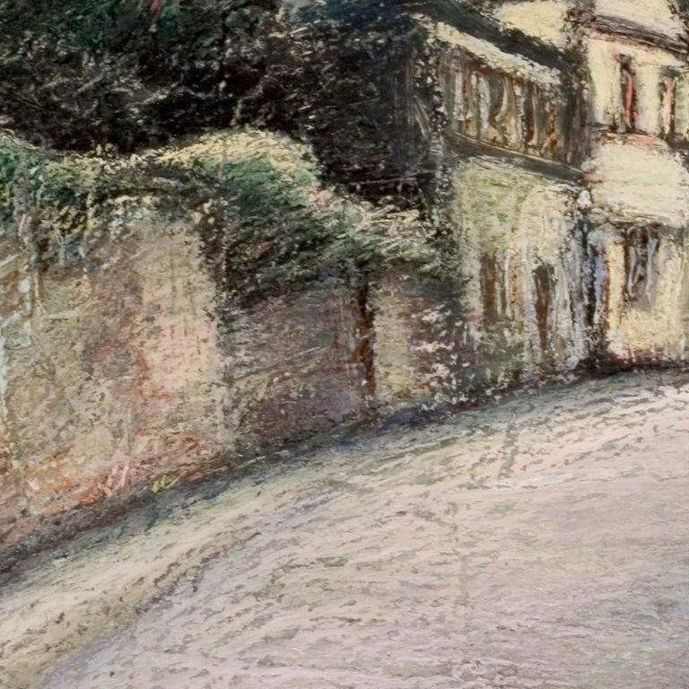 This artwork is part of a series of oil pastels from Marc Chaubaron, who aimed to keep a record of the old Saint-Goustan French port.  It features a view of a curved street, a wall, houses, trees and bush.  The pink sky indicates dusk or dawn.  The