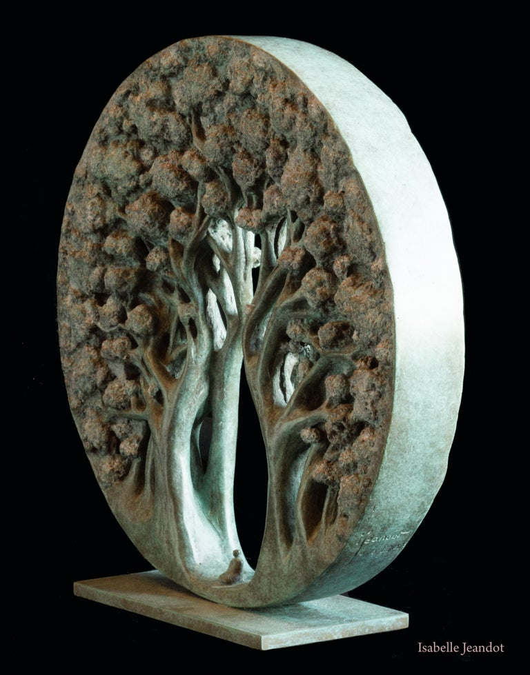 This circular sculpture depicts a small character seated on the ground, surrounded by trees.  This artwork is an allegory of the Mother Earth, with trees bending in the shape of female anatomy around the small human being.  Passionate about the