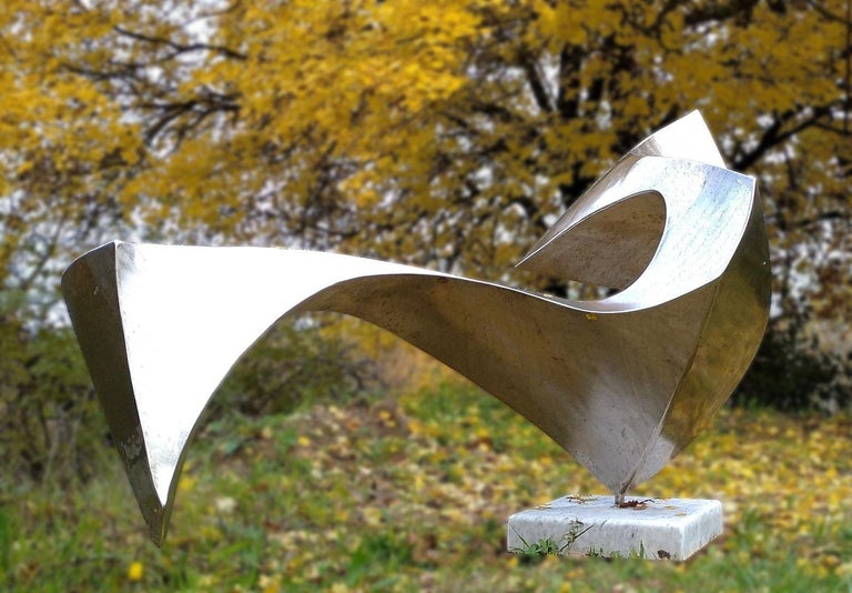 """This unique-piece abstract sculpture, named """"Swan"""", was created and shaped by Lutfi Romhein directly from 2mm thick 316L stainless steel sheets.   This artwork is very different from different angles of the gaze. It rotates on its main axis which"""