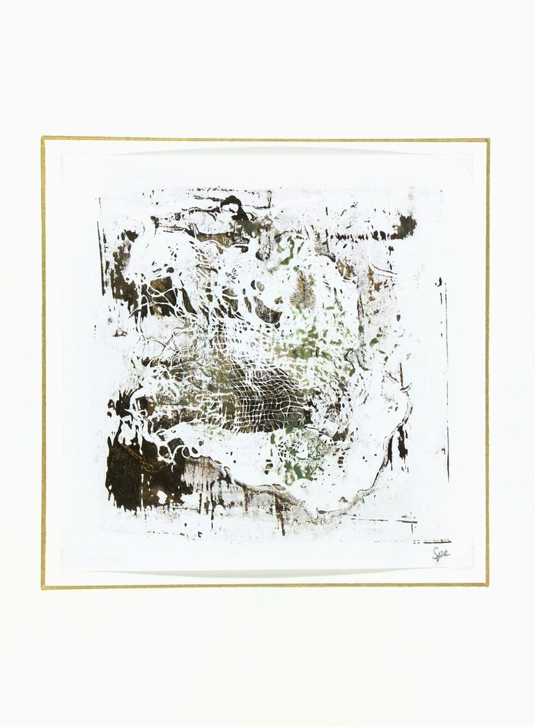 Abstract painting on dark brown and white background background with shades of gold/brown and green by English artist Spe, 2013. Signed lower right.  Original artwork on paper displayed on a white mat with a gold border. Mat fits a standard-size