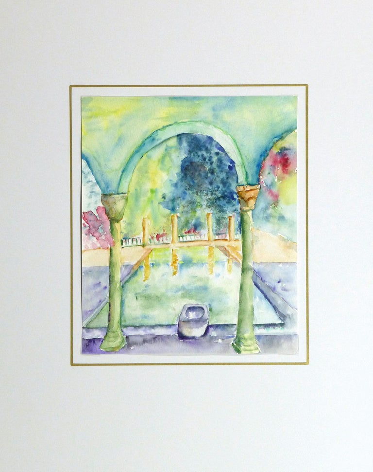 Dreamy and vibrant watercolor of a small reflective pool in the courtyard of an Italian style villa by Monique Tachdjian, 2009.   Displayed on a white mat with a gold border and fits a standard-size frame. Archival plastic sleeve and Certificate of