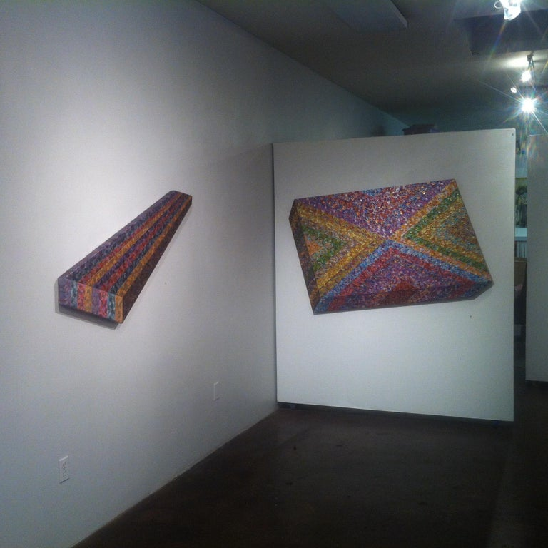 Painting on stretched canvas over sculpted stretcher bars, constructed by the artist. The work has been painted to give the illusion that it is a raised cube when in fact it is a 2-dimensional shaped canvas.   Multiple acrylic paints and acrylic
